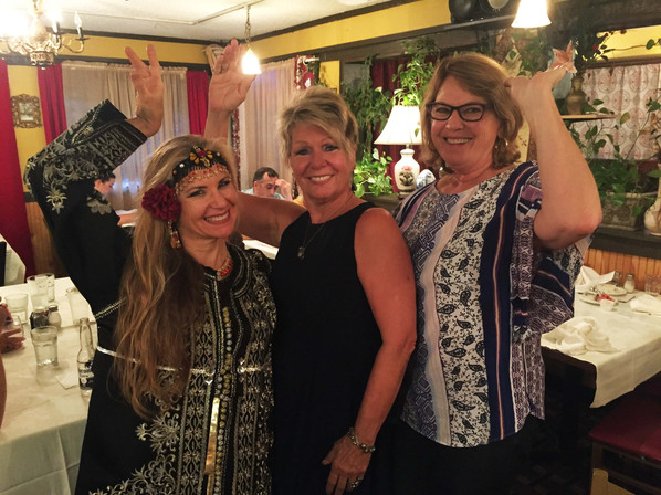 Belly Dancer Jensuya with Patrons at Alfredo's Restaurant