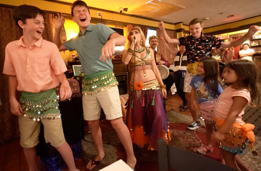 Belly Dancer Jensuya with Restaurant Patrons dancing