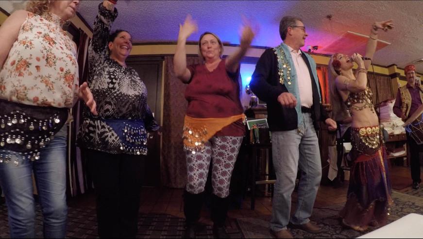 Belly Dancer Jensuya with Restaurant Patrons Dancing