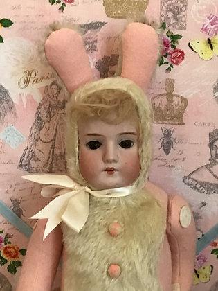 Antique doll head on artist created rabbit body
