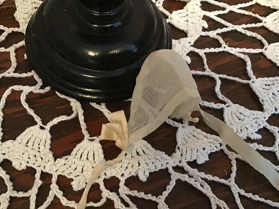 Tiny sheer bonnet with ribbon trim