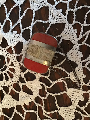 Small doll purse of velvet covered metal