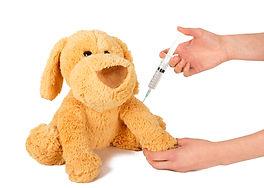 Pediatrician giving protective vaccine t