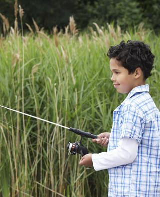 Boy fishing at Pentalago