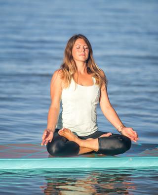 woman paddleboard yoga at pentalago