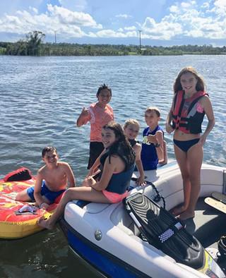Kids boating on Pentalago