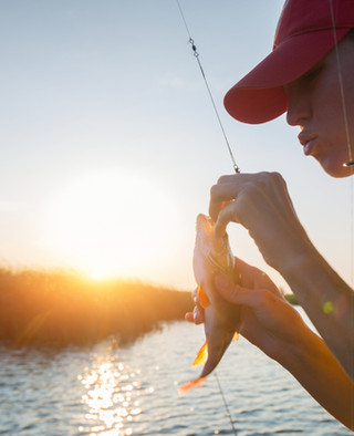 girl fishing at pentalago
