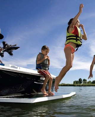 Kids jumping off boat