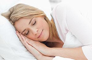 Woman having restful sleep thanks to SnorBan