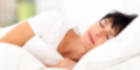 Woman having a restful nights sleep thanks to SnorBan