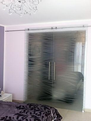porta con binario in acciaio vetro fili