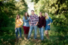 family portrait, green, grass, plaid, family, woods, trees, fall