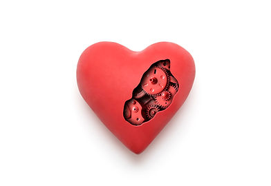 Red mechanical heart over white backgrou