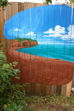 private mural on home fence of the clien