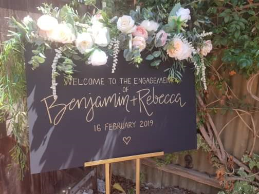 Engagement Sign & Flowers