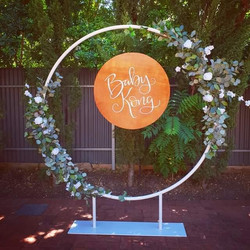 White circle arbour with flowers