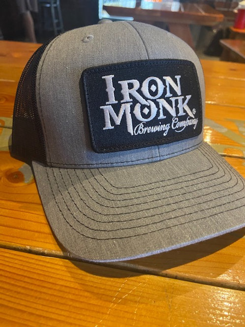 Gray front black back trucker