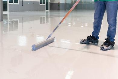 Construction series_ Worker working on epoxy floor .jpg