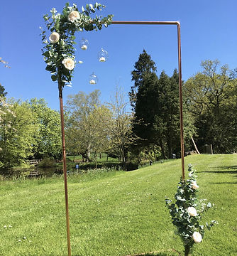 vintage wedding hire rose gold backdrop archway