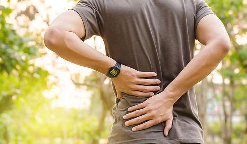 Sport injury, Man with back pain.jpg