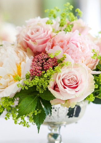 Wedding Flowers at The Dorchester Hotel. Table centrepiece at The Penthouse and Pavilion.