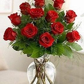 12 Roses in  a vase.