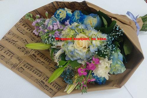 Designer choice Wrapped bouquet, no vase.