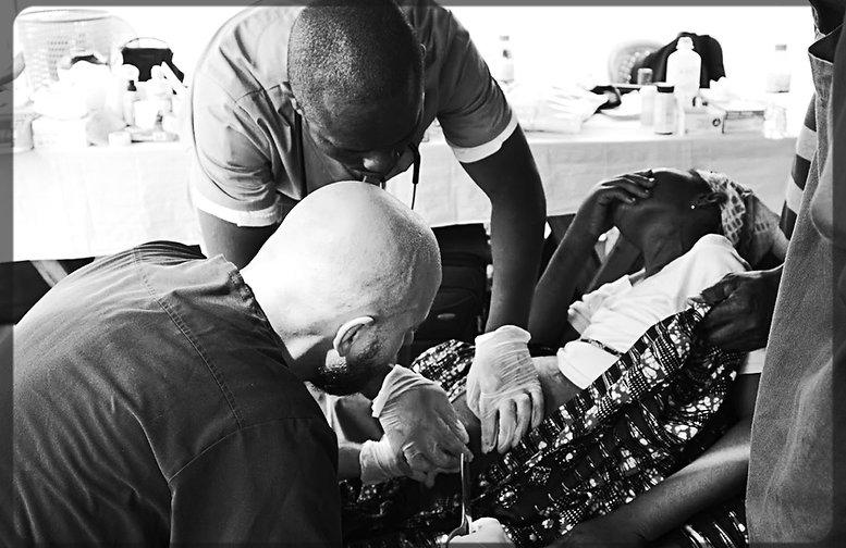 Dr. Komi Folly and Tony Edwards work on