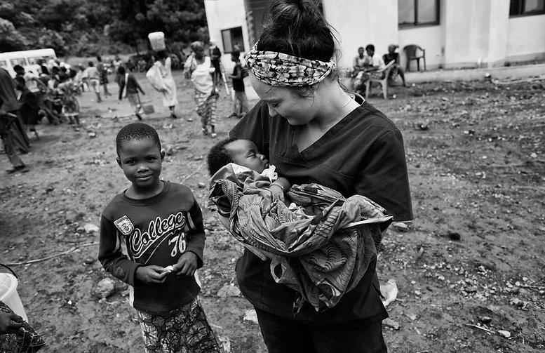 LWDF volunteer Jamie Orr holding a baby