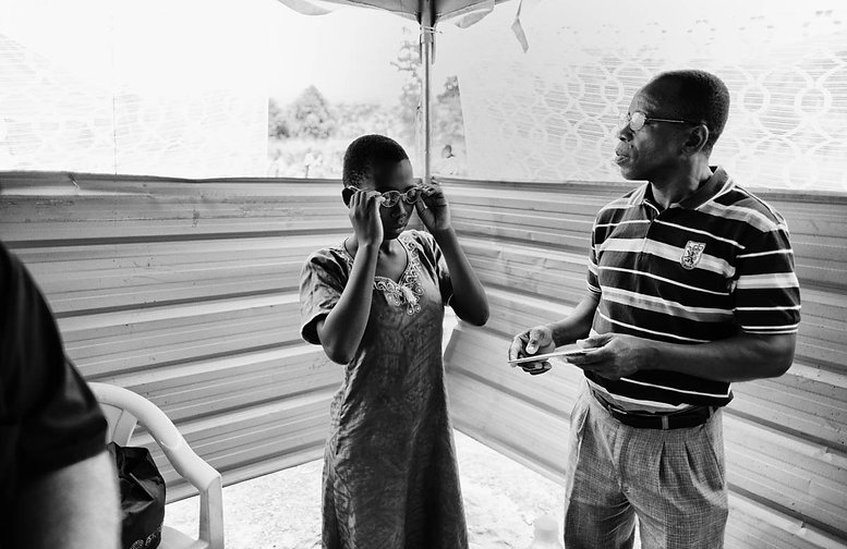 Woman Being Fitted for Glasses at Togo C
