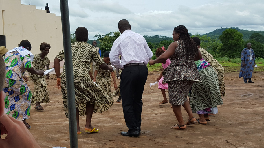 Dr. Folly participating in the cultural dance and singing during the ribbon cutting ceremony July 2016