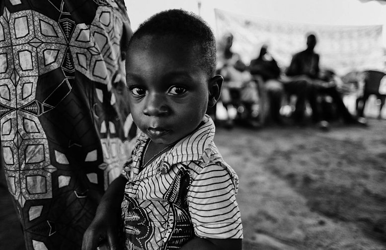 Young boy at Togo Clinic 2016.jpg