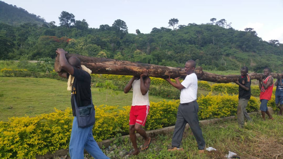 Dr. Folly helping to build a bridge on a portion of the road that was washed out by heavy rains at the clinic in Agou, Togo.