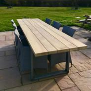 Iroko garden table with steel box legs