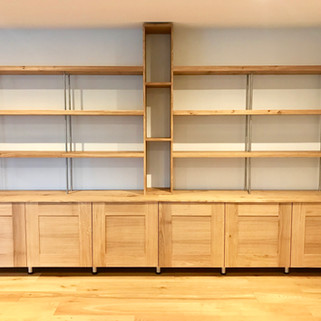 Oak and stainless steel shelving system with cabinets below