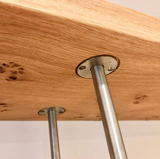 Bespoke fixing detail for Oak and stainless steel shelving system