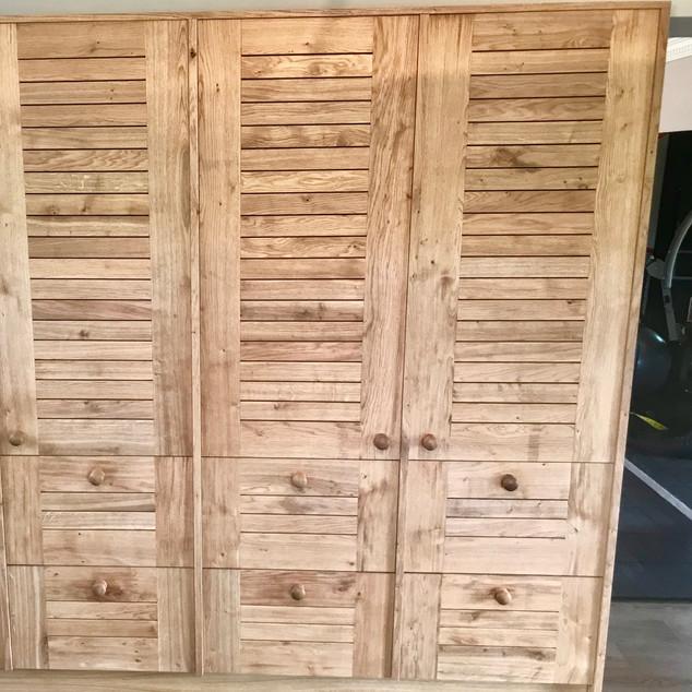 Oak office filing cabinet wall