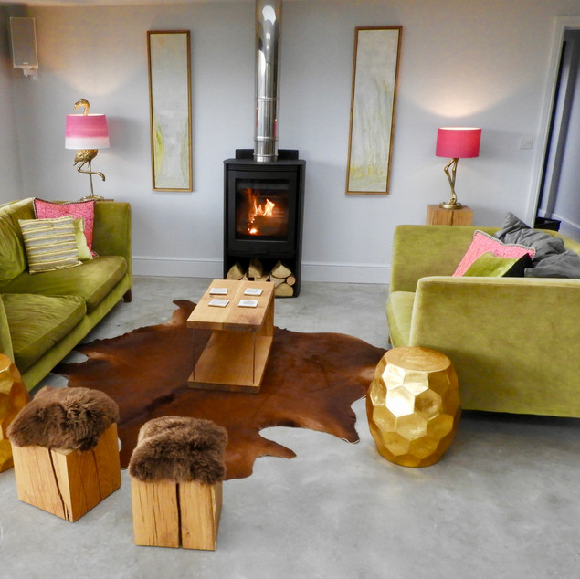 stools and coffee table from oak and sheepskin