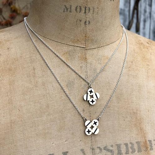Diamond Shaped Silver Screws Pendant by Connie Verrusio