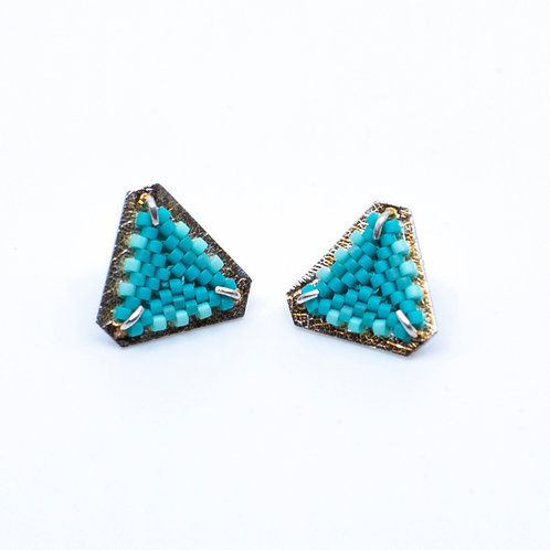 Turquoise Flat Triangular Posts by Claudia Fajardo