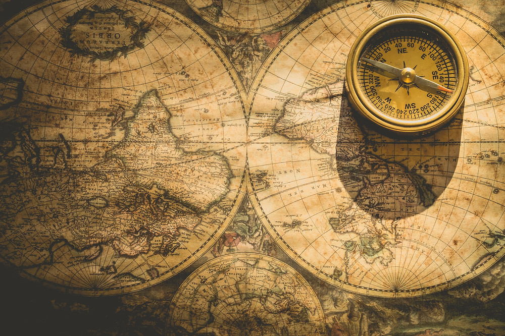 the map of padar island with a golden compass on top of it. It shows the itinerary of the 3 days tour to Padar island Indonesia