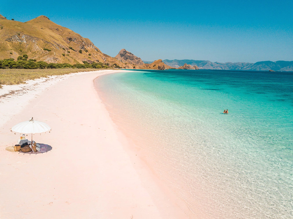 Padar island pink beach called Long Beach. Padar island tour with Labalaba Boat. Private komodo liveaboard cruise in Indonesia