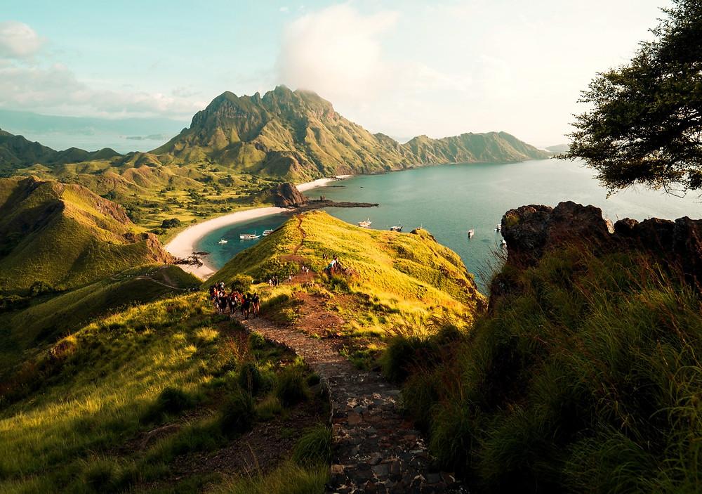 Padar island hike after sunrise. one day trip to Padar island in Indonesia.