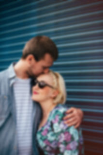 couple kissing in urban setting on midlands engagement soot