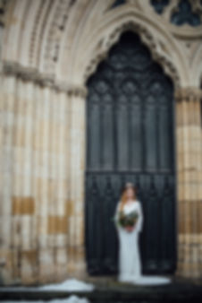boho bride wearing shikoba dress standing in front of york minster