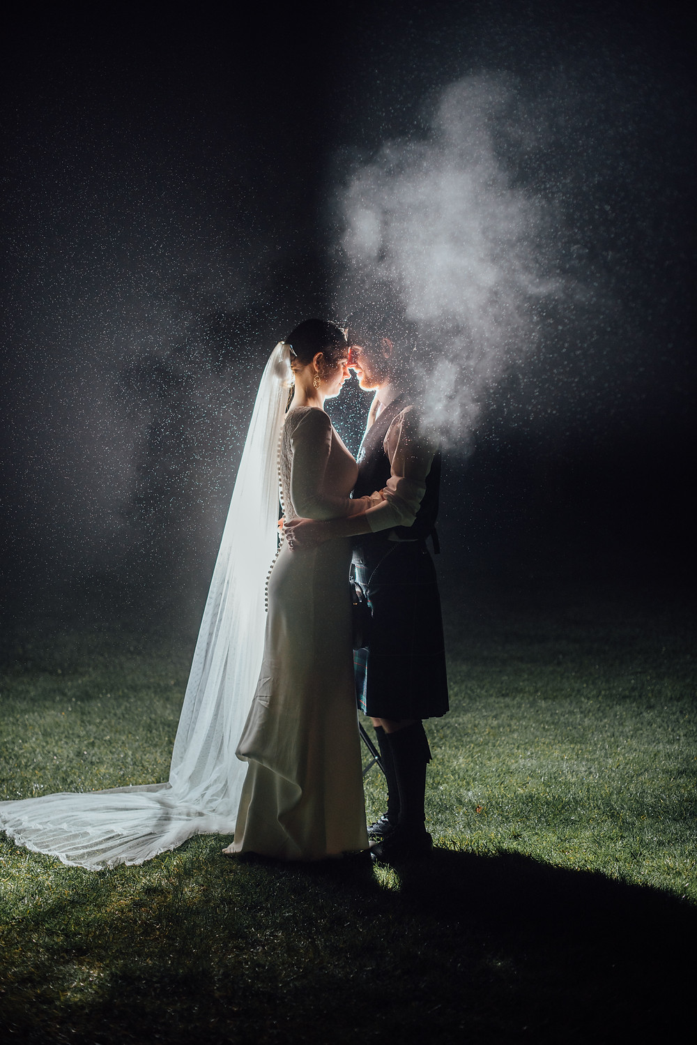 Bride and groom nighttime portrait at Kirknewton Stables Wedding