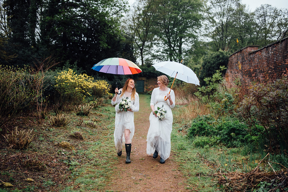 Brides having fun on rainy wedding day