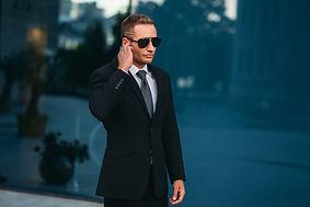 male-bodyguard-uses-security-earpiece-ou