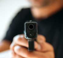men-with-handgun-close-up-PHC7QQN_edited
