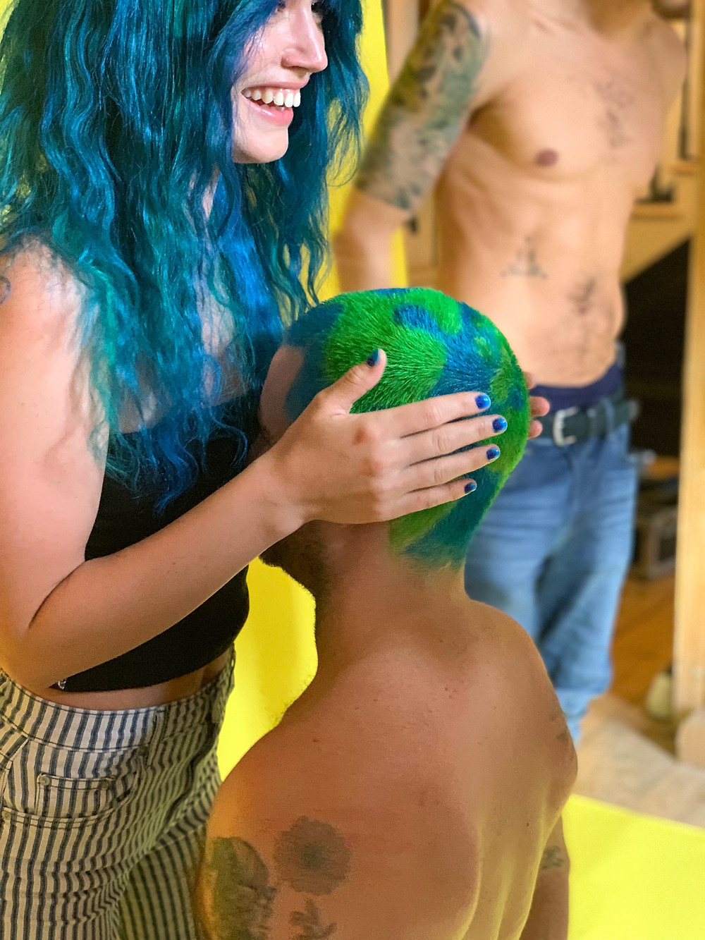 georgia may jagger holds a guys head which has been dyed by bleach london